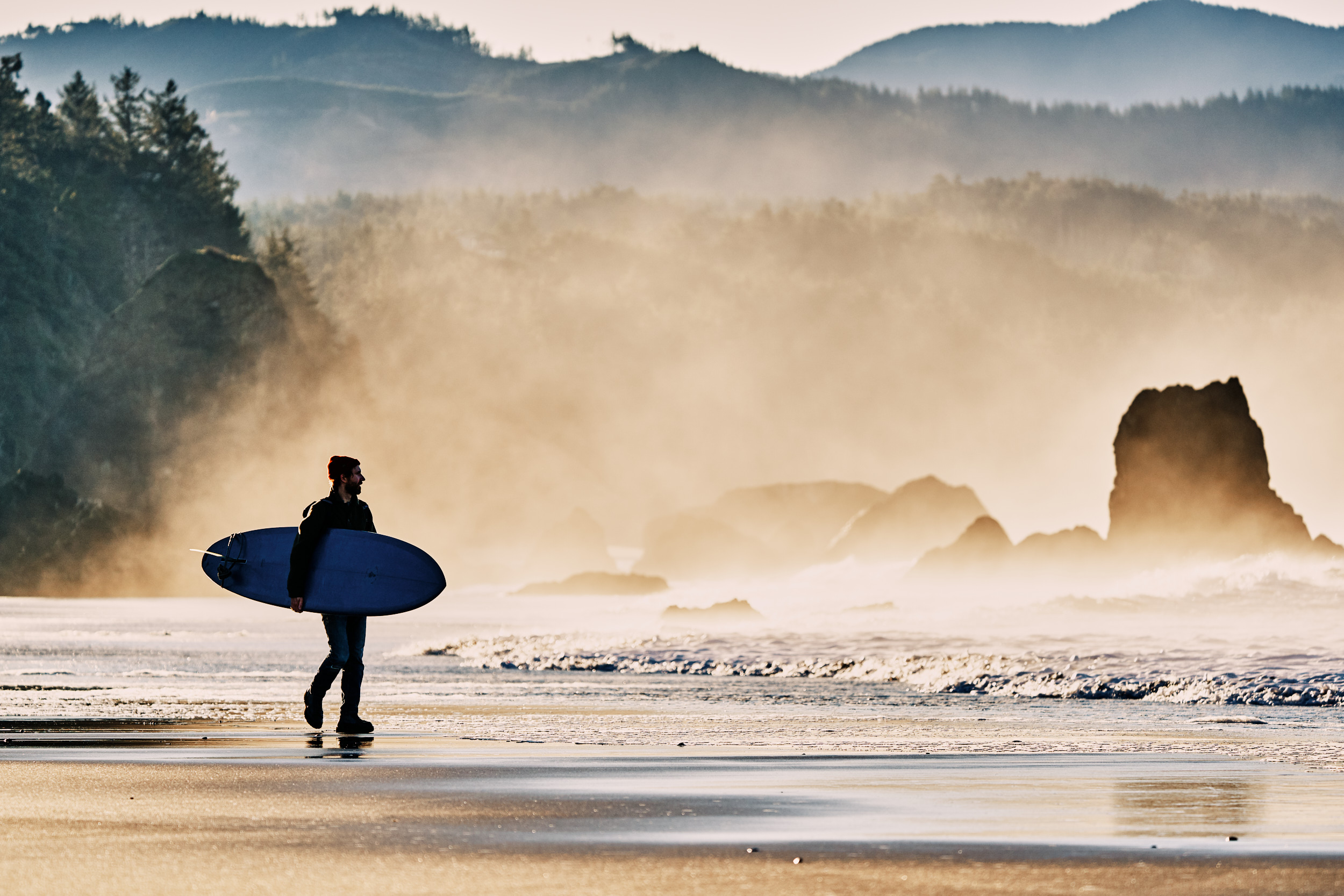 Surfer looking for waves on the Southern Oregon Coast wearing Danner Mountain Light