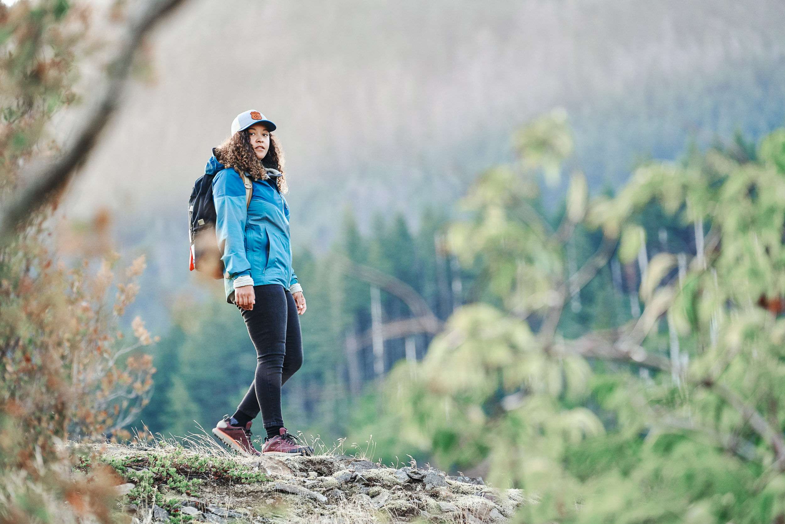 Women hiker enjoying the morning light on the Pacific Crest Trail wearing Danner 2650.