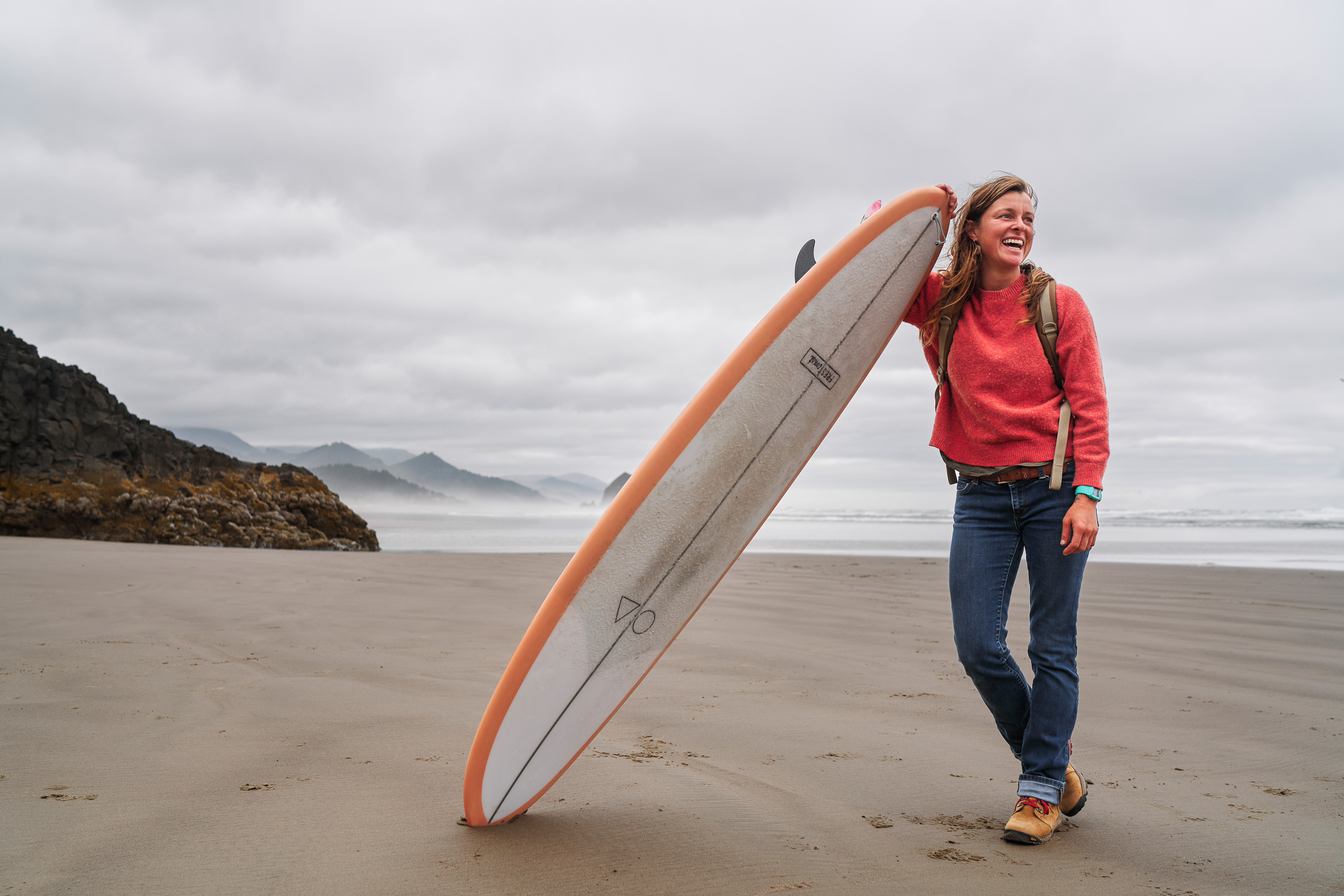Lauren Ahlgren of Oregon Surf Adventures wearing Danner Inquires on Cannon Beach, OR