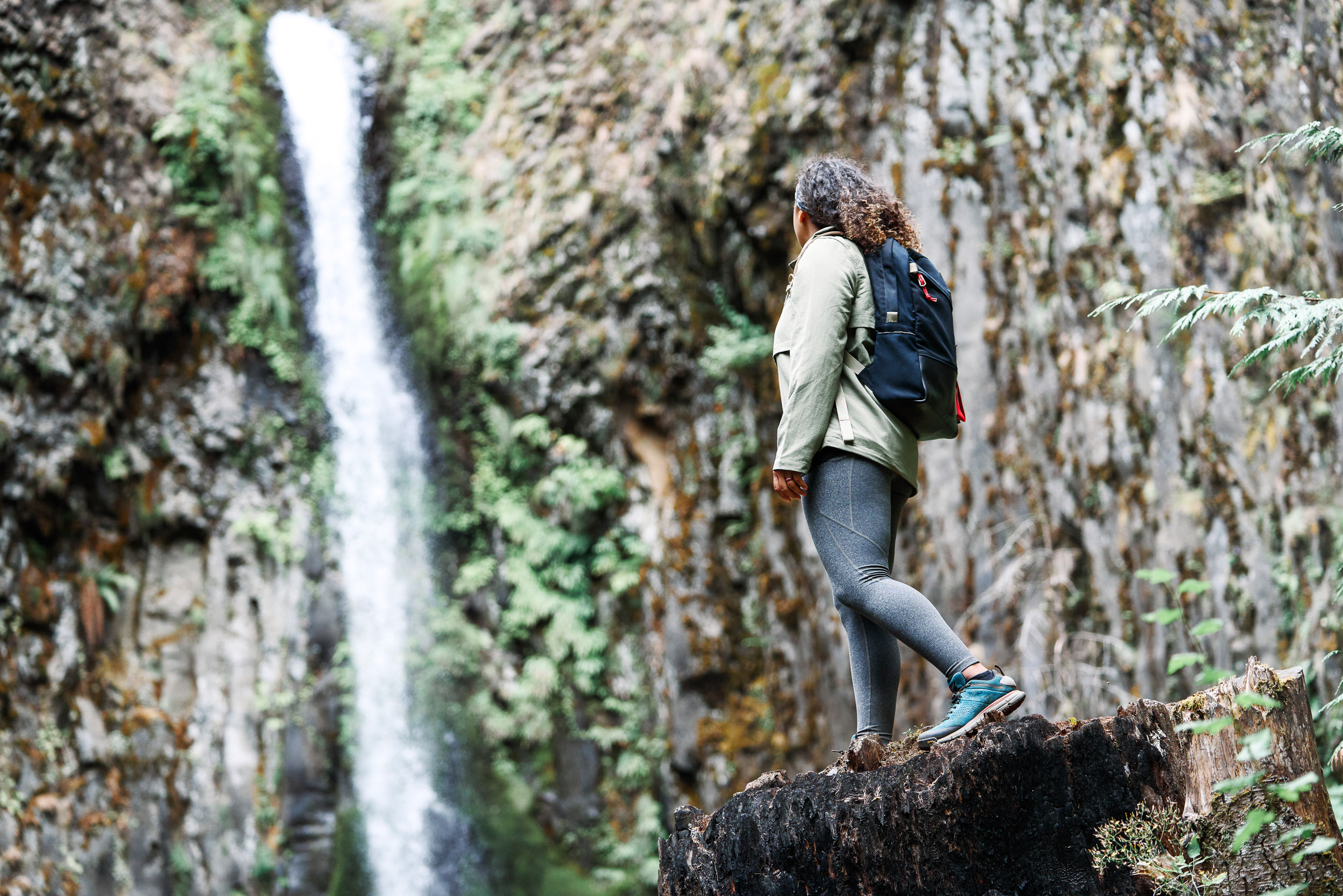 Women Hiking Pacific Crest Trail wearing Danner 2650 while looking at a water fall.