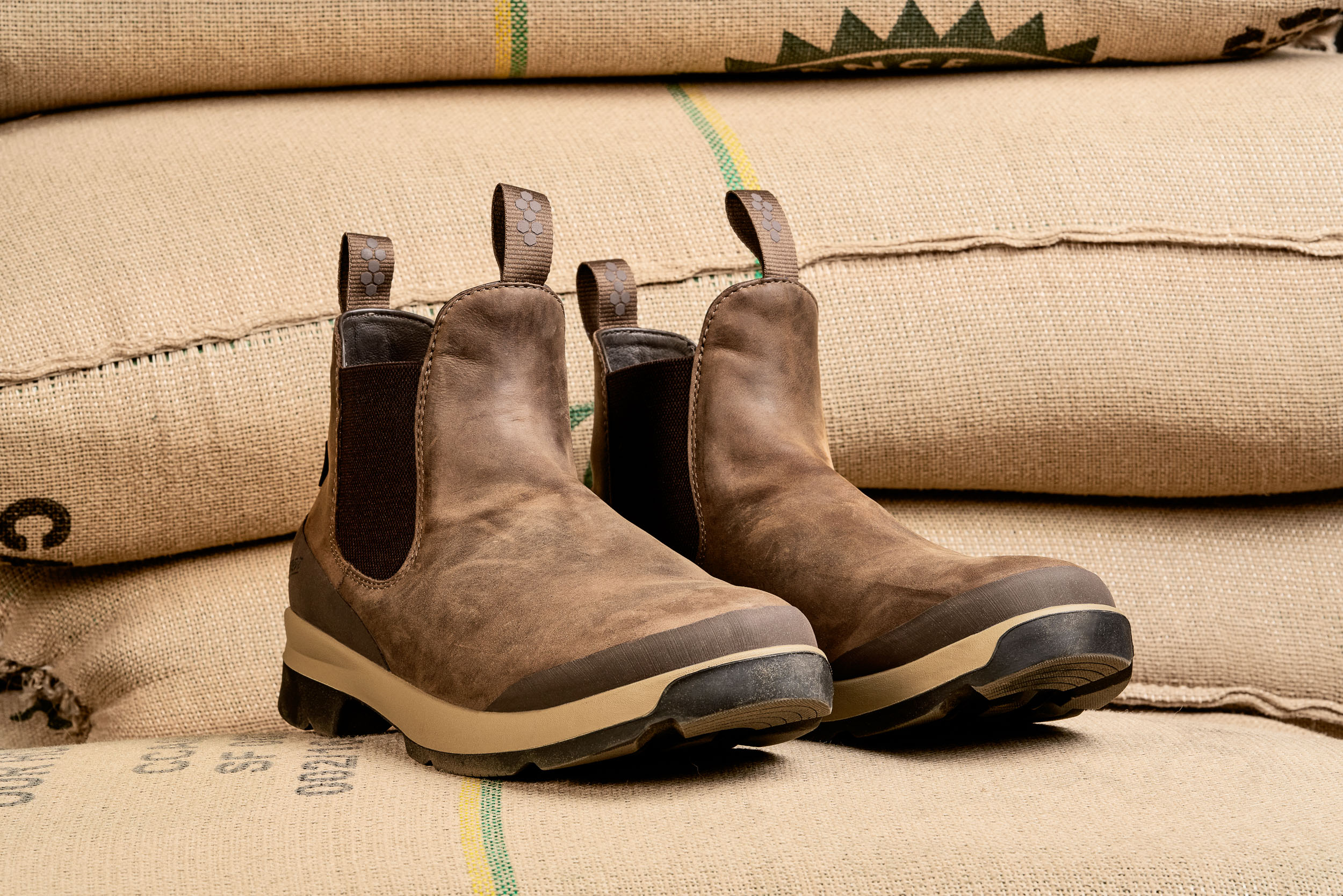 Product photo of the Danner Pub Garden on sacks of un roasted coffee at Coava