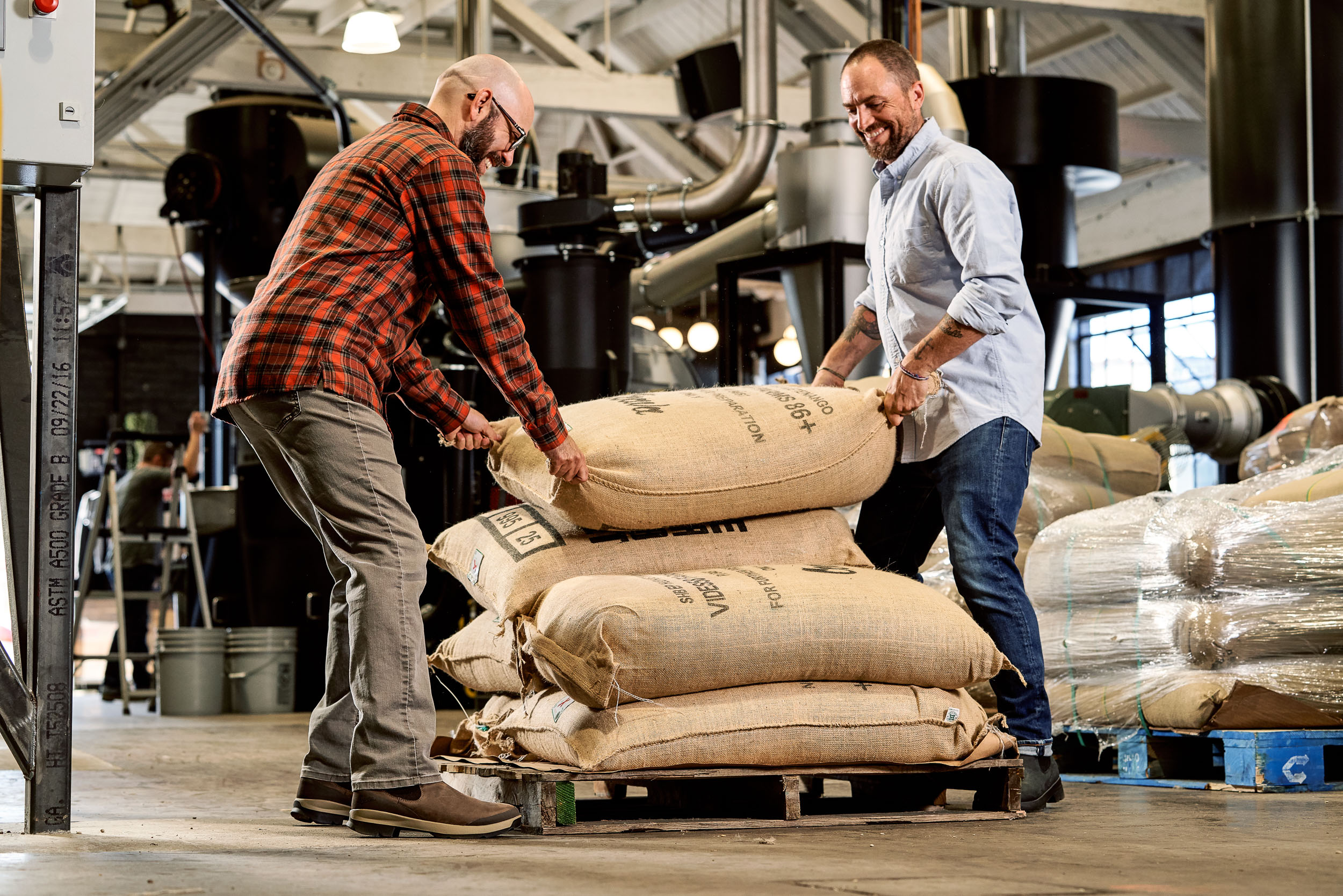 Moving sacks of green coffee at Coava Roasters in Portland, OR while wearing Danner Pub Gardens